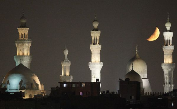 The moon looms over the mosques of old Cairo