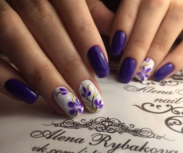 The Bold Spring Nail Art Design Cover Your Nails With This Amazing Bluish Purple And White Flowers Carved Over