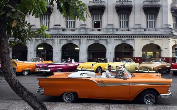HAVANA, CUBA - SEPTEMBER 16: A taxi driver sits in a vintage American car on September 16, 2015 in H... - Getty Images