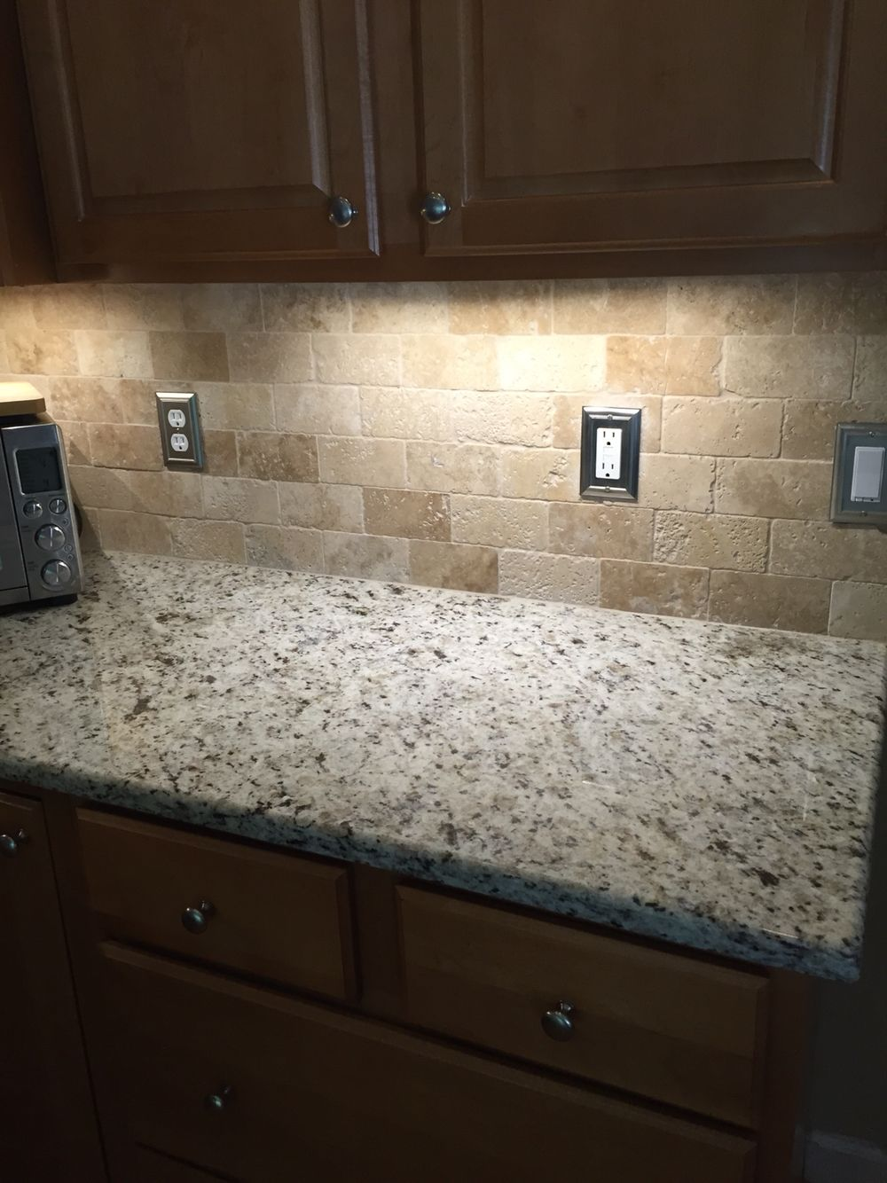 Travertine Herringbone Kitchen Backsplash With Accents