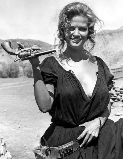 Claudia Cardinale | desert | gun | trick | cowgirl | fun | beauty | movie set | juggle | www.republicofyou.com.au