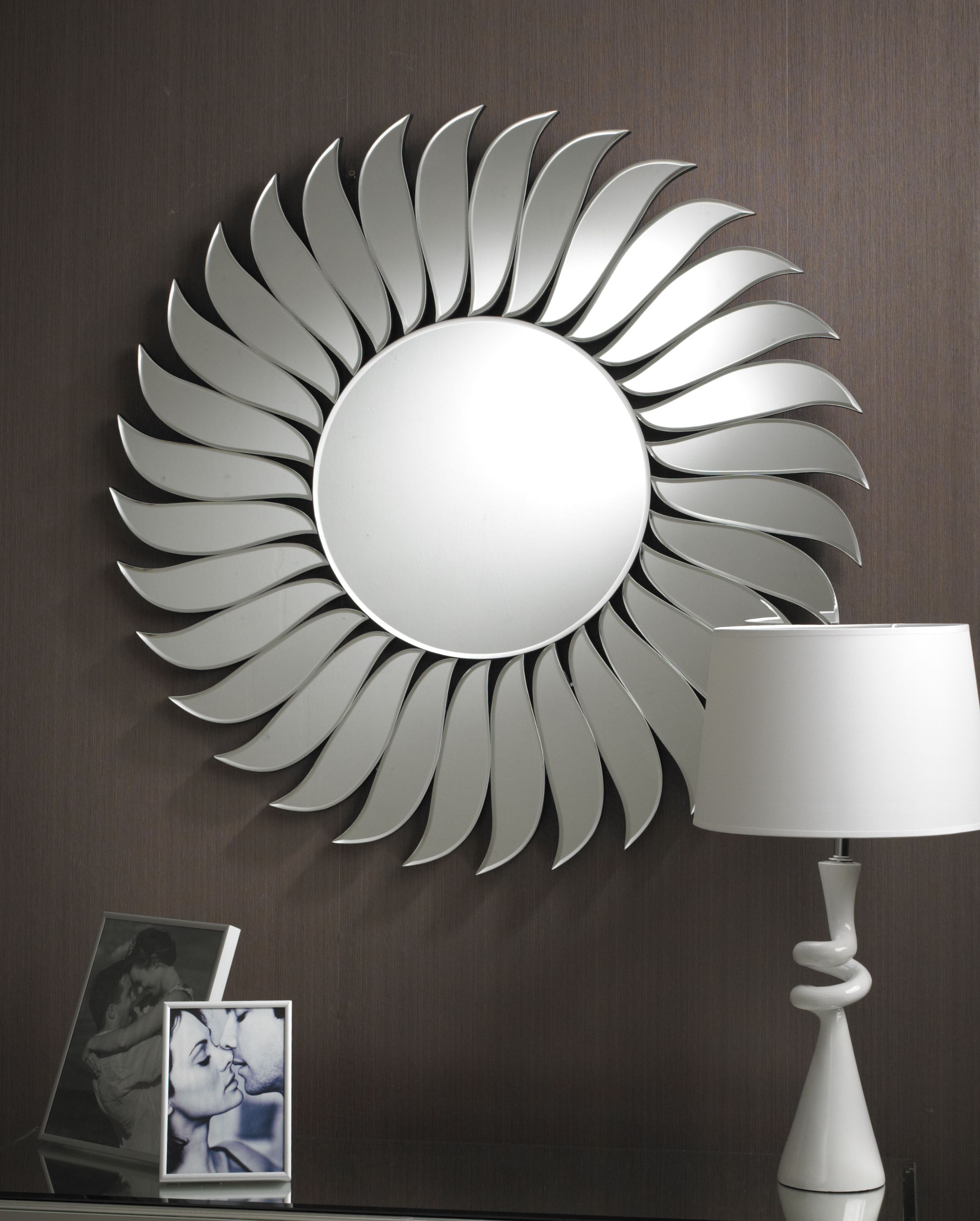 The Wave is a fascinating circular Art Deco mirror in clear bevelled glass. The simple circle on the inside is surrounded by a border of beautiful leaf like glass pieces which at the same time give a feeling of movement, while giving the impression of a flower; simply enchanting. http://www.chicconcept.co.uk/round-mirrors/3102-art-deco-wave-mirror-5055157622285.html