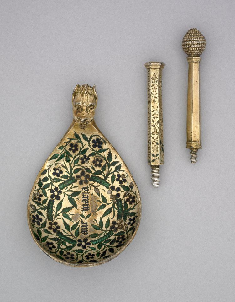 Spoon; silver-gilt; bowl enamelled both sides with floral designs in green and black; in the centre an inscription in black enamel; octagonal stem engraved partly on one side with a legend and joined to the bowl by a monster's head; the spoon unscrews into three pieces to fit into a leather case.