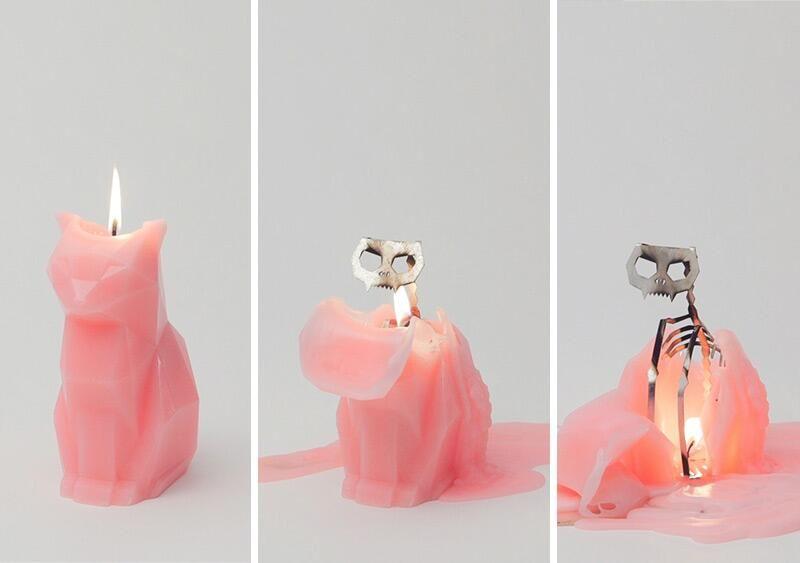 Burning Cat Candle, revealing skeleton inside.
