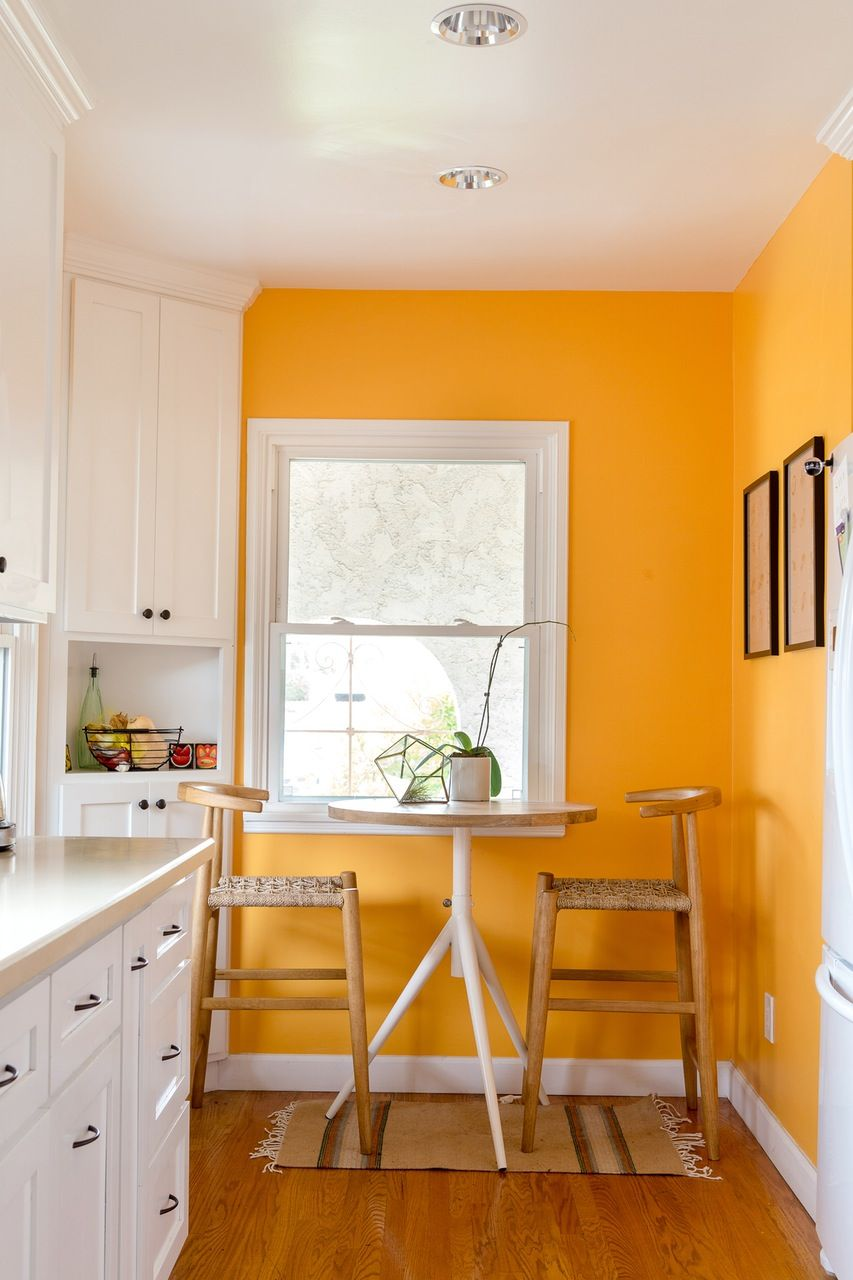 Your Breakfast Nook With A Burst Of Bold Yellow Balance The Look White Cabinets Furniture And Decor Along Some Softer Natural Wood Tones