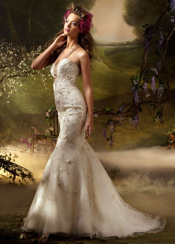 Ivory hand beaded and embroidered tulle trumpet formal bridal gown, sweetheart neckline, chapel train.