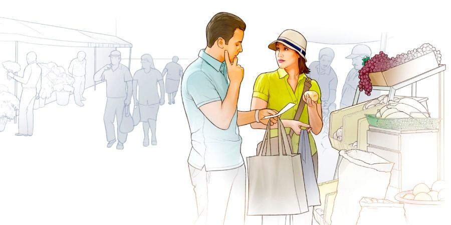 A couple consult a list while out shopping together