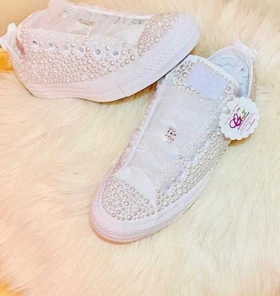 Pearls covered all over the shoes with bows in the back!