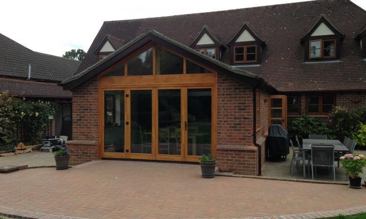 Image result for rear kitchen extension with oak bi folds