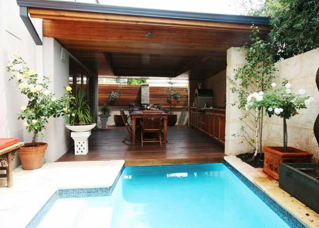 pool cabana ideas breezeway by suspending a decking over the long lap pool
