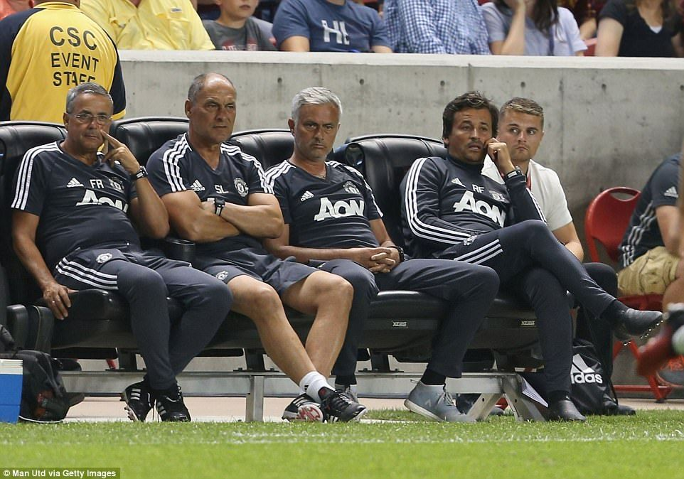Mourinho watches on from the bench with the rest of his