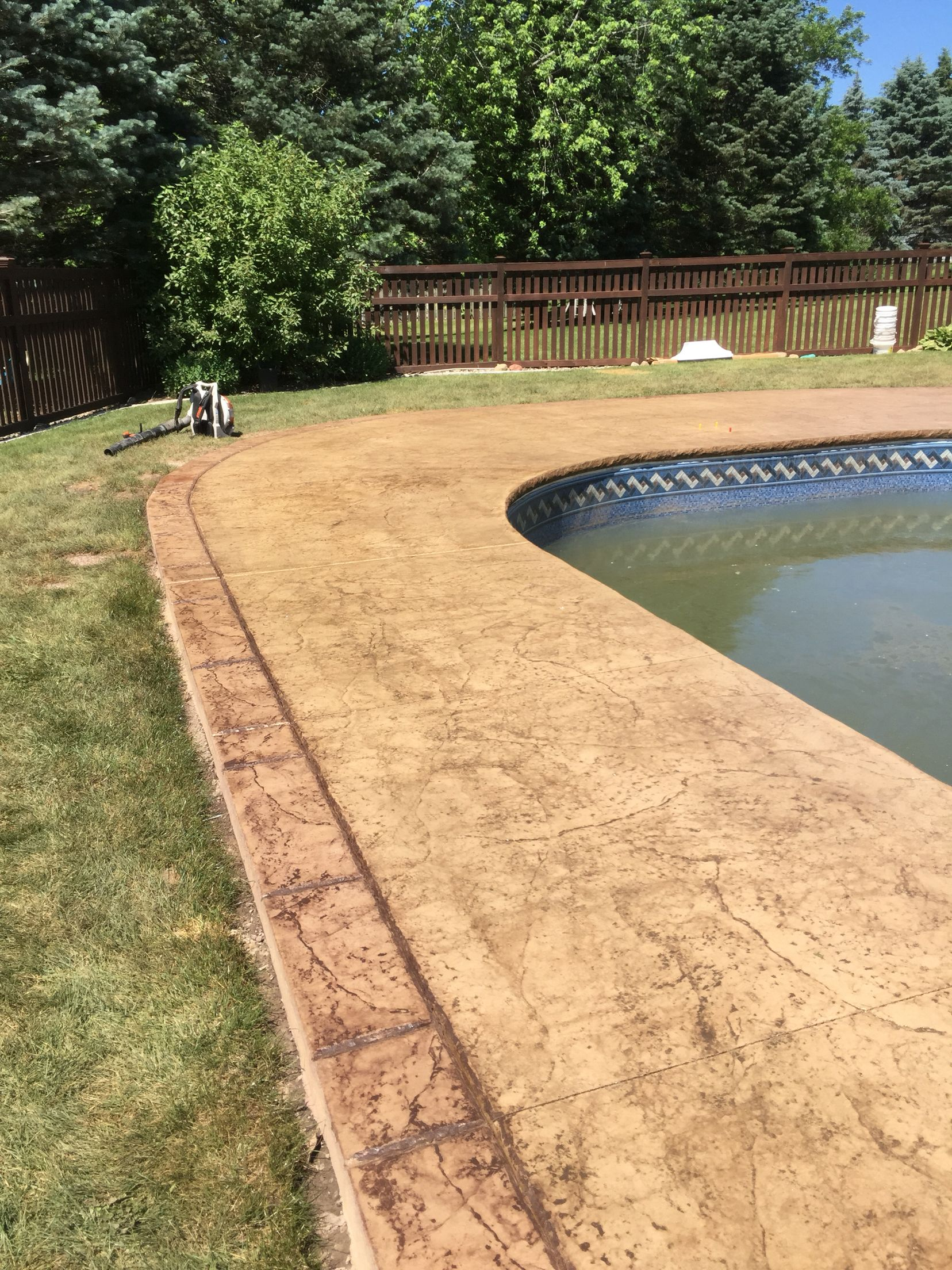Stamped concrete pool deck with custom chiseled stone cantilevered ...