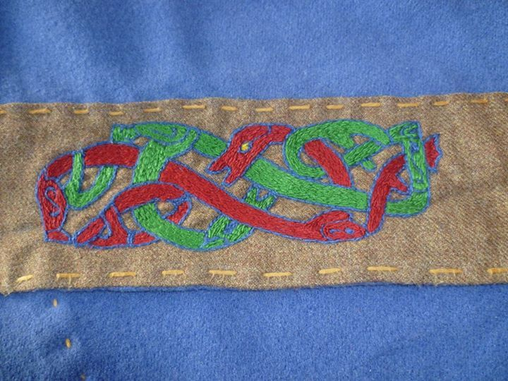 Fornafolket - Viking Age Reenactment.Detail of the orm-themed embroidery motif.