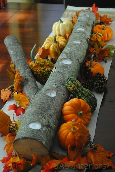 Thanksgiving table centerpiece. Could use the same log & use different decorations for Christmas, too!