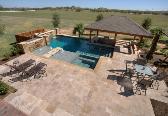 Texas Pools and Patios serves Austin, San Antonio, Georgetown, and Central Texas. Custom swimming pool and spa photo gallery.