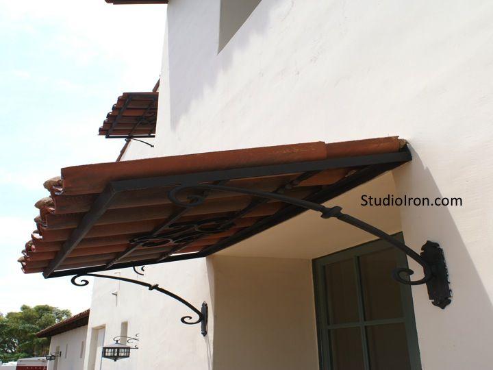 Tiled Roof And Iron Awning Spanish Style Homes Spanish Patio Pergola