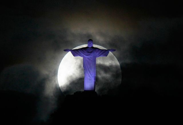The full supermoon behind the massive statue of Christ the Redeemer above Rio de Janeiro, Brazil. May 6, 2012
