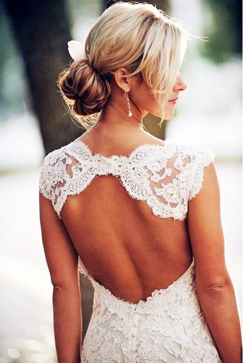 Backless Lace Wedding Dress . The shape of the back of this gown is amazing.
