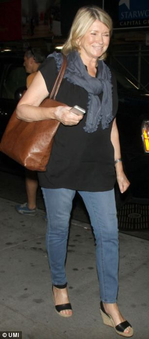 Sir Patrick Stewart wears tight T-shirt and fedora hat as