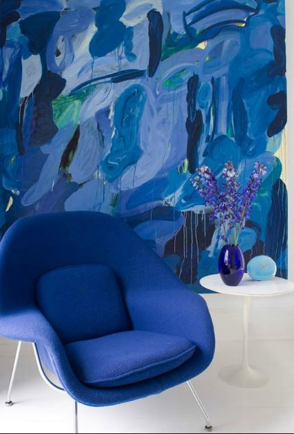 blue Womb chair against blue artwork, Hampton's home of Lisa Perry