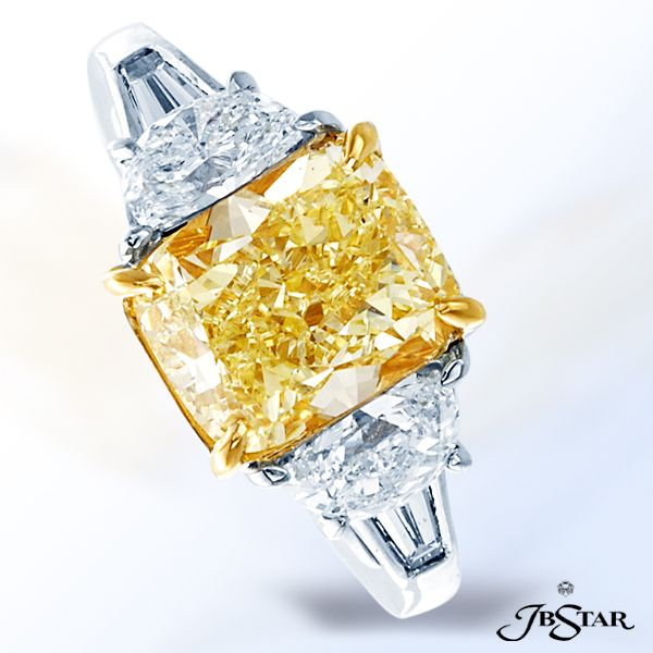 Style 2347 Fancy yellow diamond ring featuring a magnificent 3.38 ct radiant fancy yellow diamond, embraced by half moon and tapered baguette diamonds. Platinum/18KY. @jewelsbystar #fancyyellow #diamond #ring