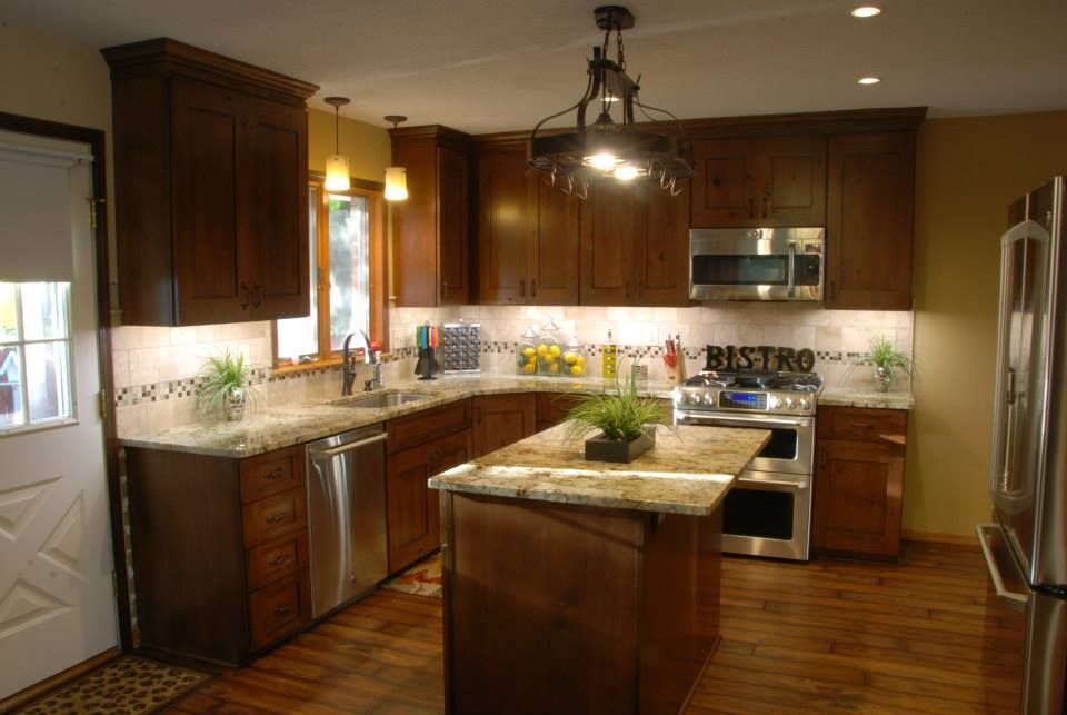 Knotty alder cabinets, granite, backsplash, flooring, lighting ...
