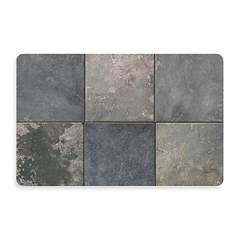 This go-anywhere mat has the look of elegant slate tiles. It'll provide a decorative touch as well as a no-slip spot, and cushioning for wet, tired or cold feet.