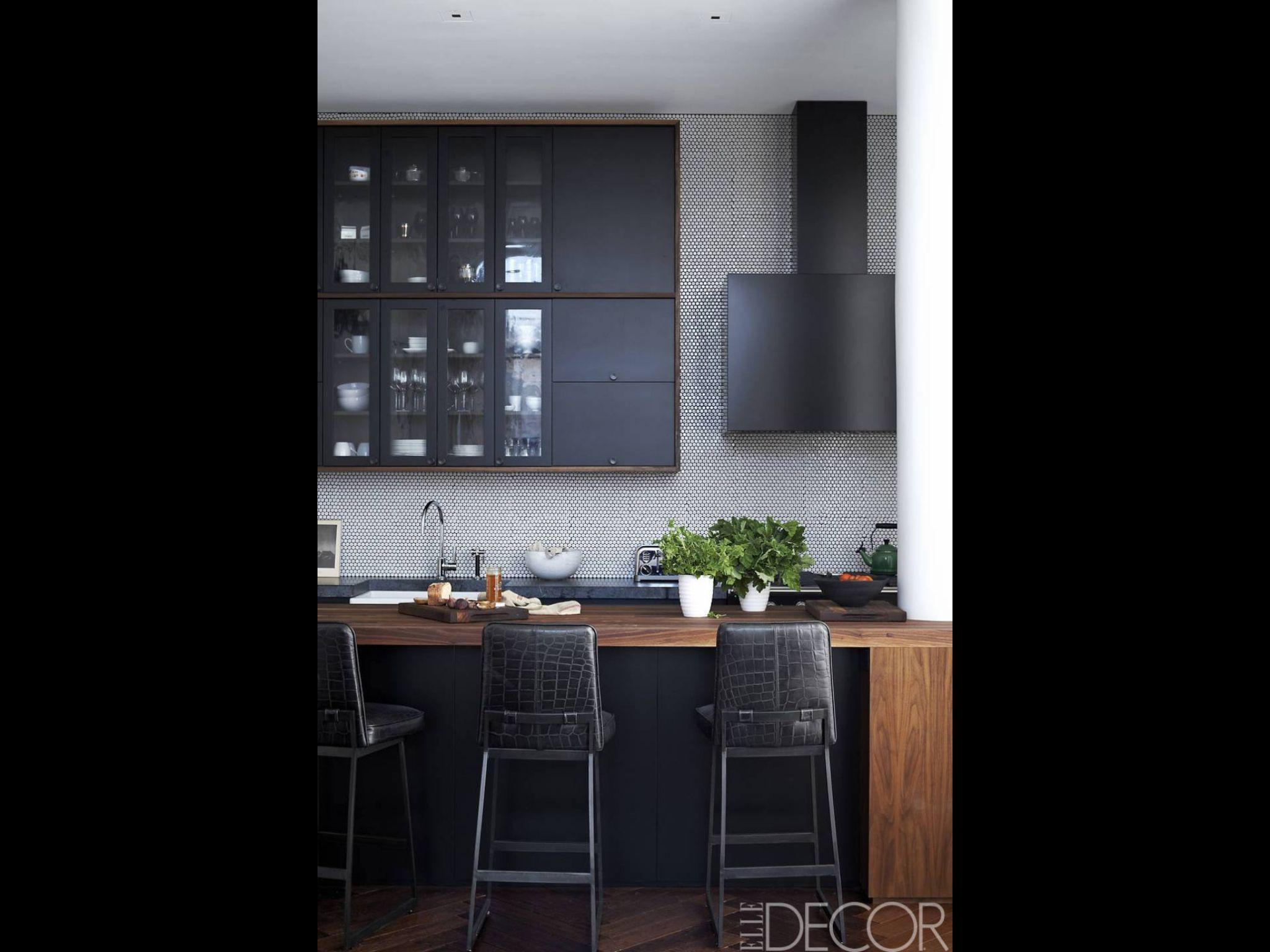 penny tile backsplash black cabinets combined with