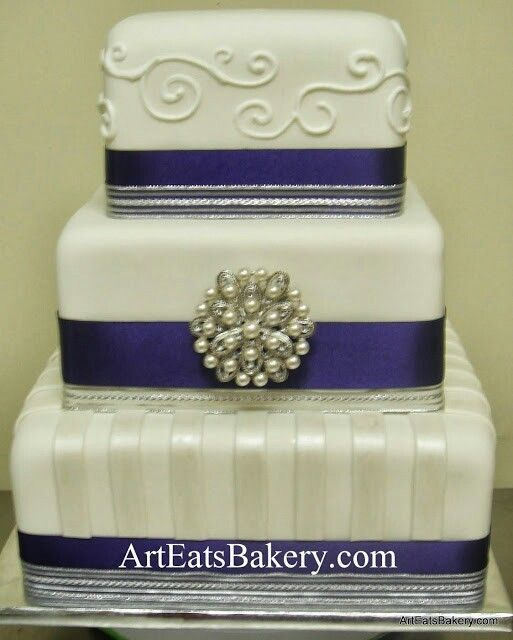3 Tier White Fondant Modern Unique Square Wedding Cake Design With Royal Icing Swirls Pearl Stripes Blue Ribbons And Silver Brooch