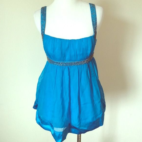 Blue Beaded Strap Cami Bright blue beaded Bebe Top with adjustable straps. NWT, comes with extra beads just in case. Brand new! bebe Tops Camisoles