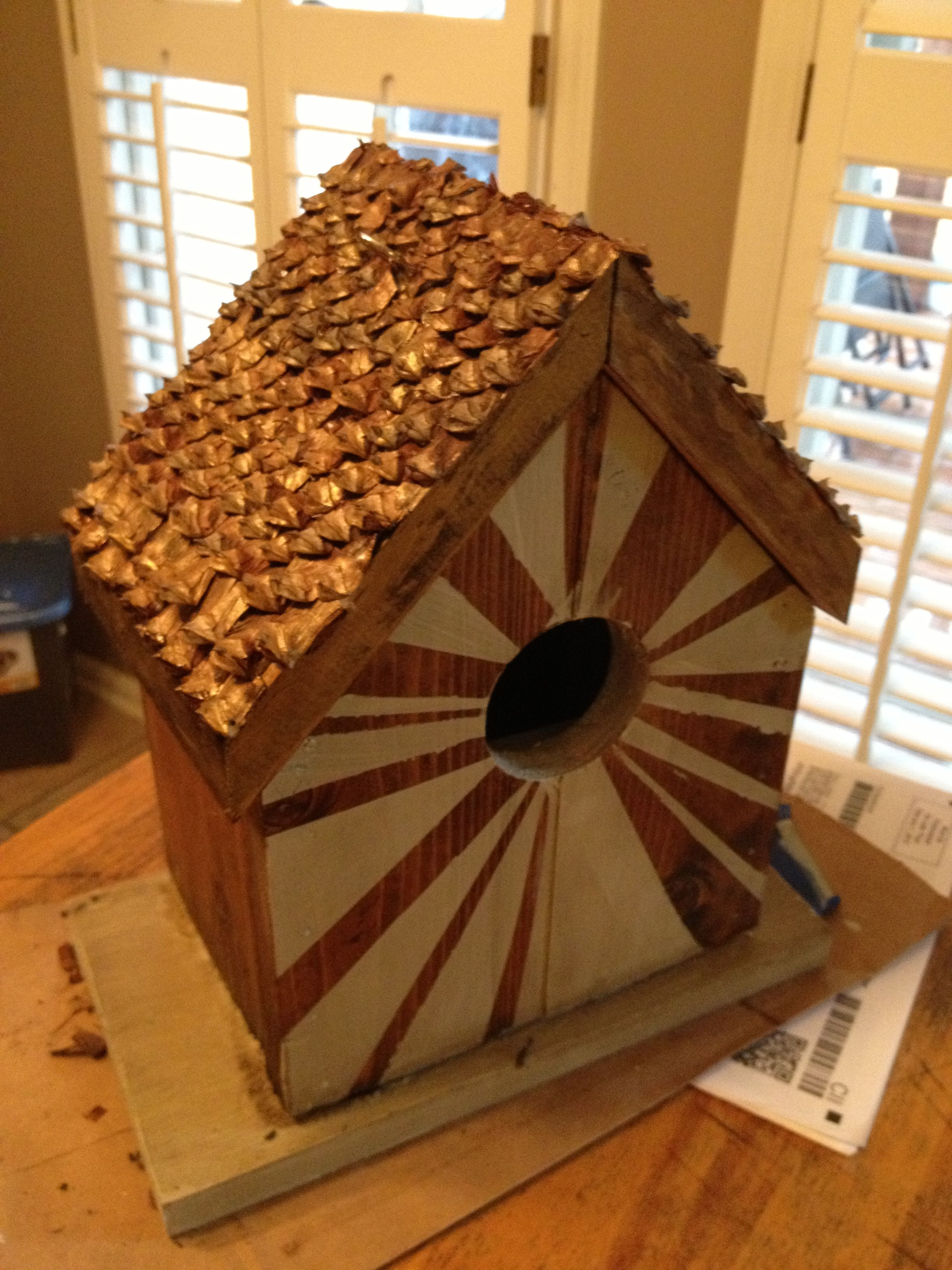 DIY bird house out of scrap wood. Glued pinecone pieces to make the ...