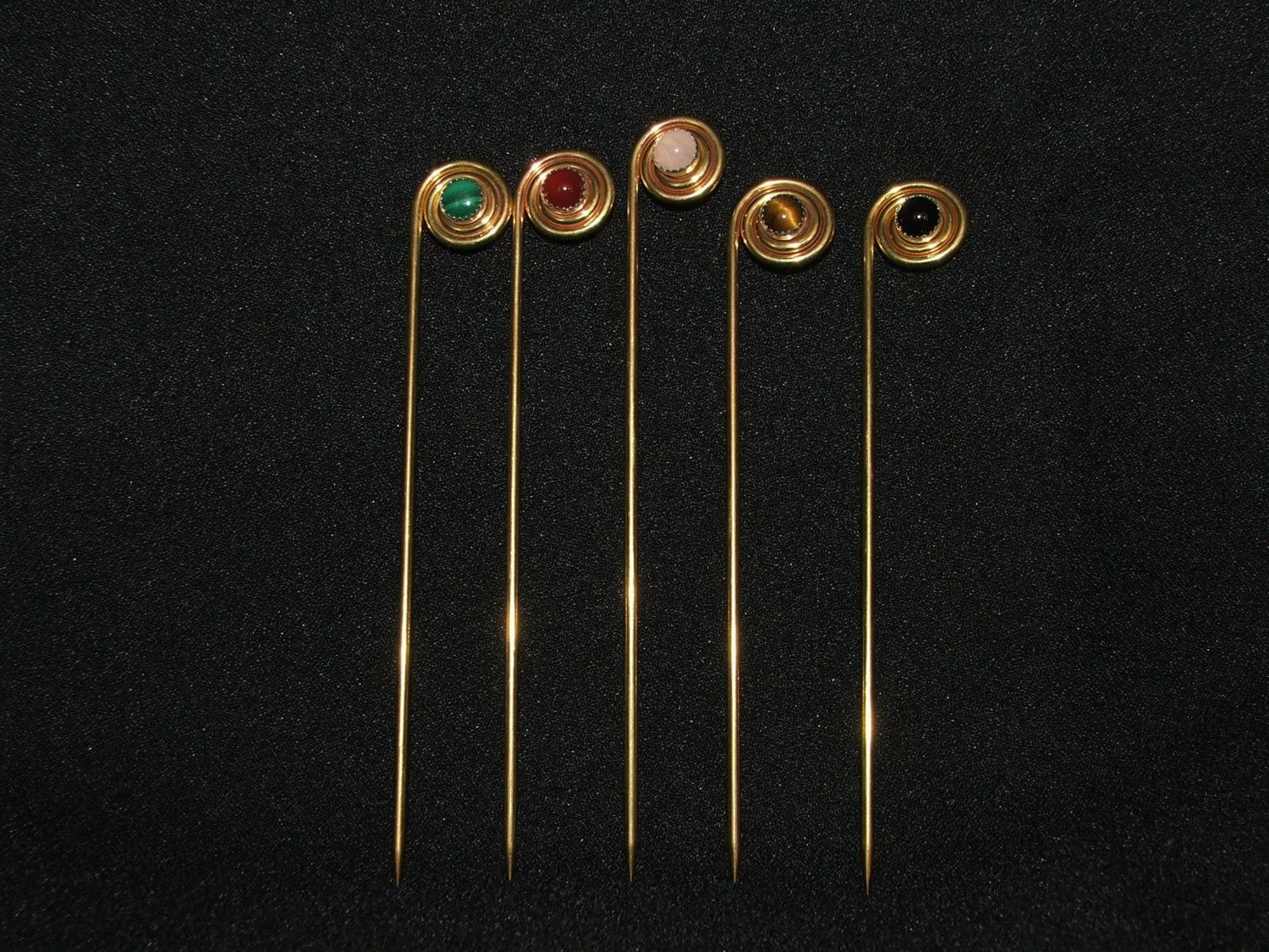 Spiral pins, brass with 8mm stones mounted in Sterling.