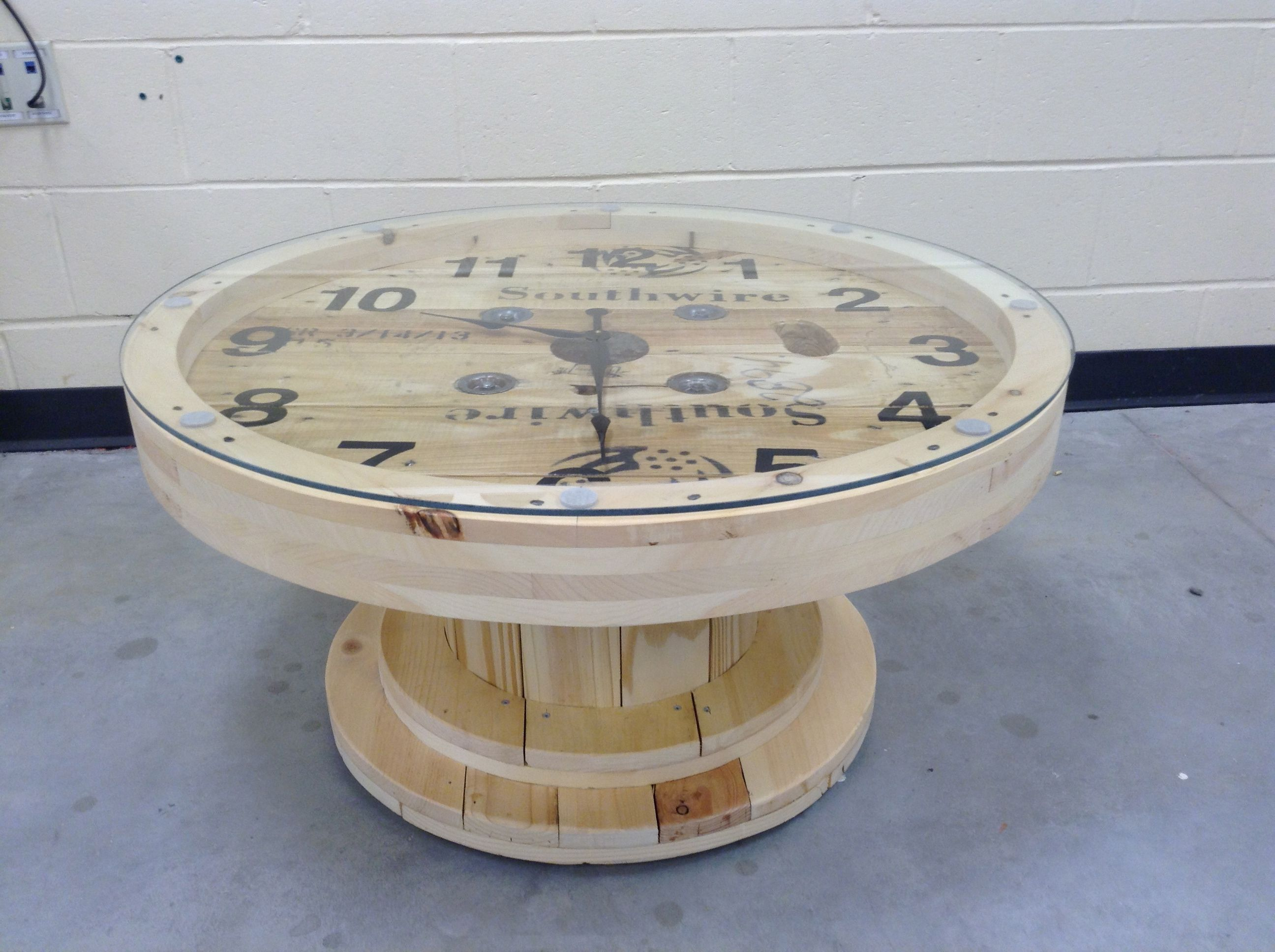 A cable wire spool made into a coffee table clock for Wire coffee table