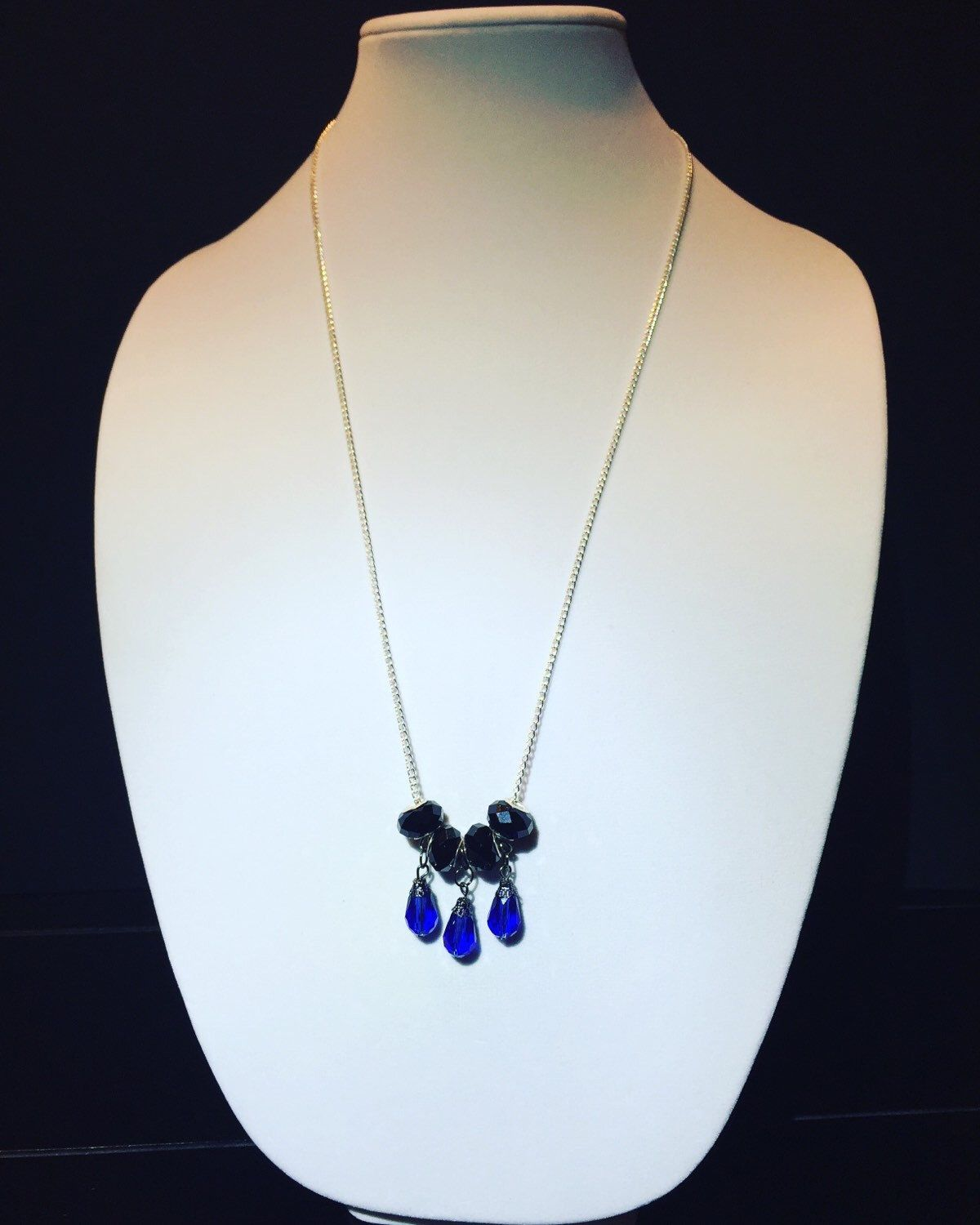 A personal favorite from my Etsy shop https://www.etsy.com/listing/260466477/blue-charm-necklace
