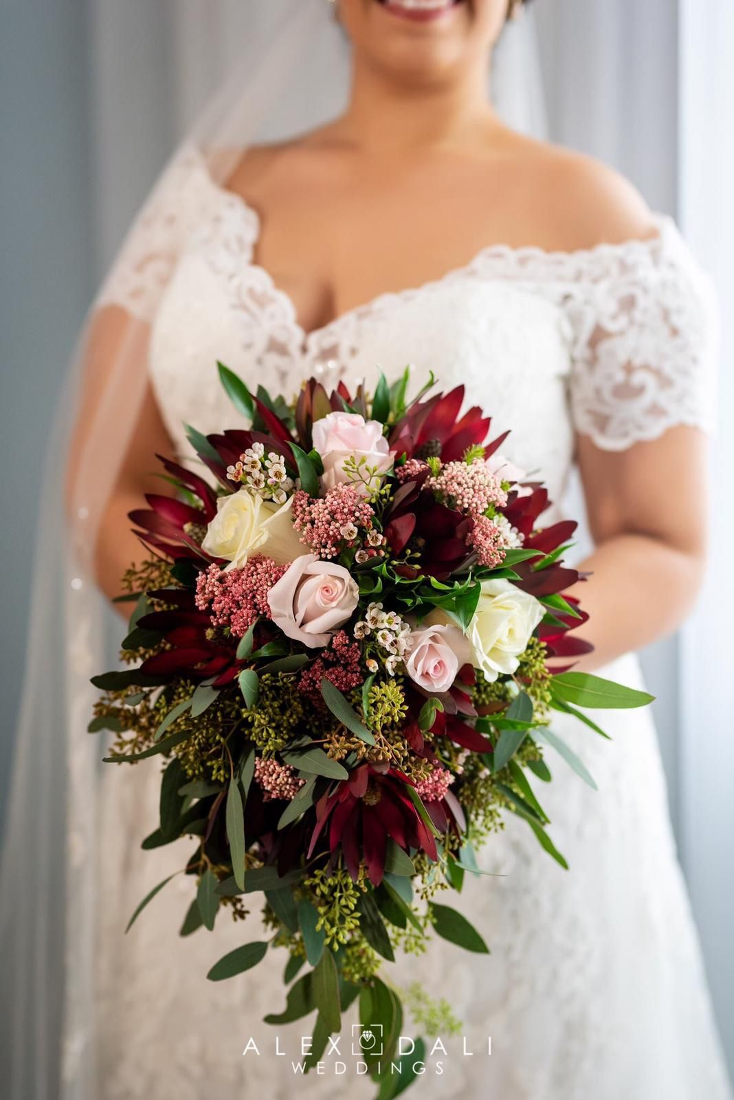 Cascade bridal bouquet burgundy and light pink Roses safari sunset