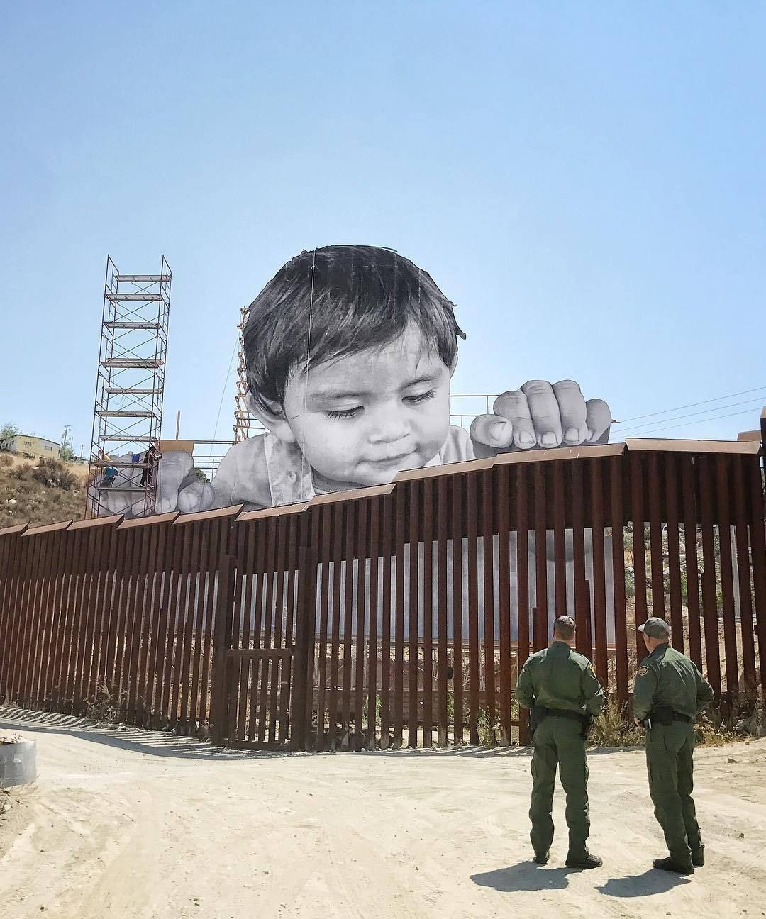 """itscolossal: """"A Child Peers Over the US/Mexico Border Wall in a Giant New Photographic Work by JR """""""