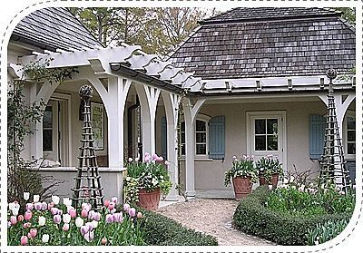 this beautiful pergola would be right at home next to a cape cod style home just love the color of the spring tulips design by ahbl in washington - Cape Cod Style House Colors