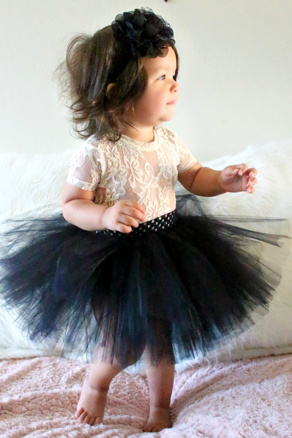 7c568e024e Make sure she looks sweet and playful for a family photo shoot in this black  tutu set from Beautiful Bows Boutique. Customized just for her, it features  a ...
