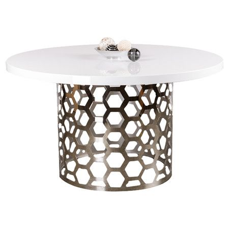 Showcasing a stainless steel openwork base with a geometric design, this elegant dining table adds a modern touch to your decor.   Produ...