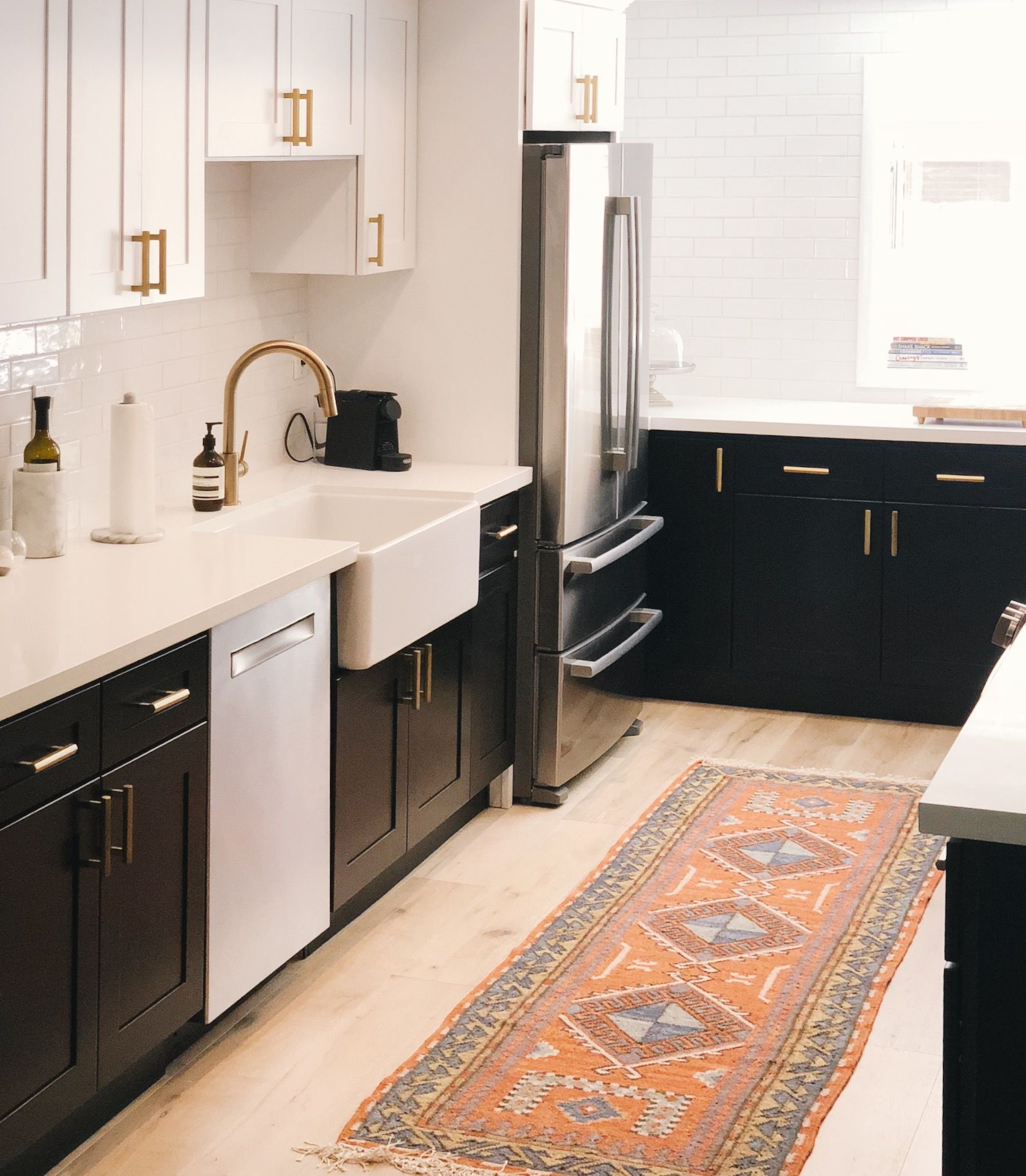 A modern two toned kitchen design Simple touches such as the gold