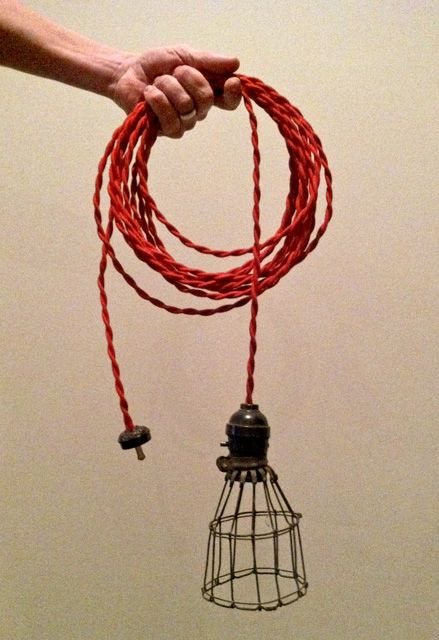 LOVE  a red cord with a cage light for a sleek industrial look :: pendants over cafe