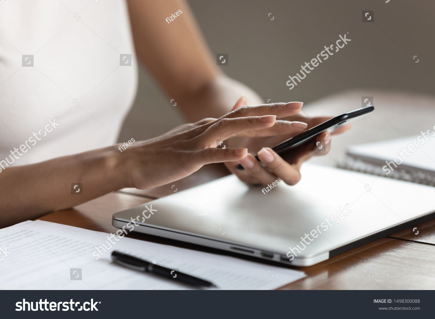 Crop close up of successful woman worker employee using modern cellphone typing texting message young female hold smartphone browsing fast wireless internet on cell techn...