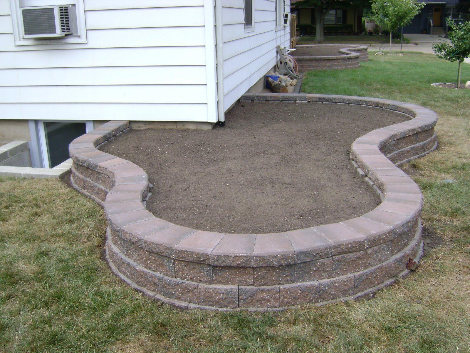 005 retaining wall garden bed off corner of house garden for Corner vegetable garden ideas