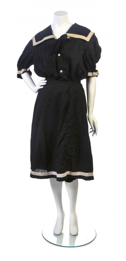 Circa 1900 black middy-style bathing suit with a white trimmed sailor collar, bloomers, and detachable over skirt. Via Leslie Hindman Auctioneers.