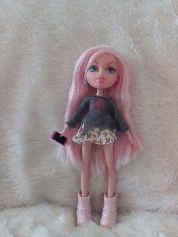 This Is The Bratz Doll Named Chloe She Has Long Pink Hair Big Blue Eyes A Floral Print Skirt Pink Boots Wit Floral Print Skirt Long Pink Hair Floral Prints