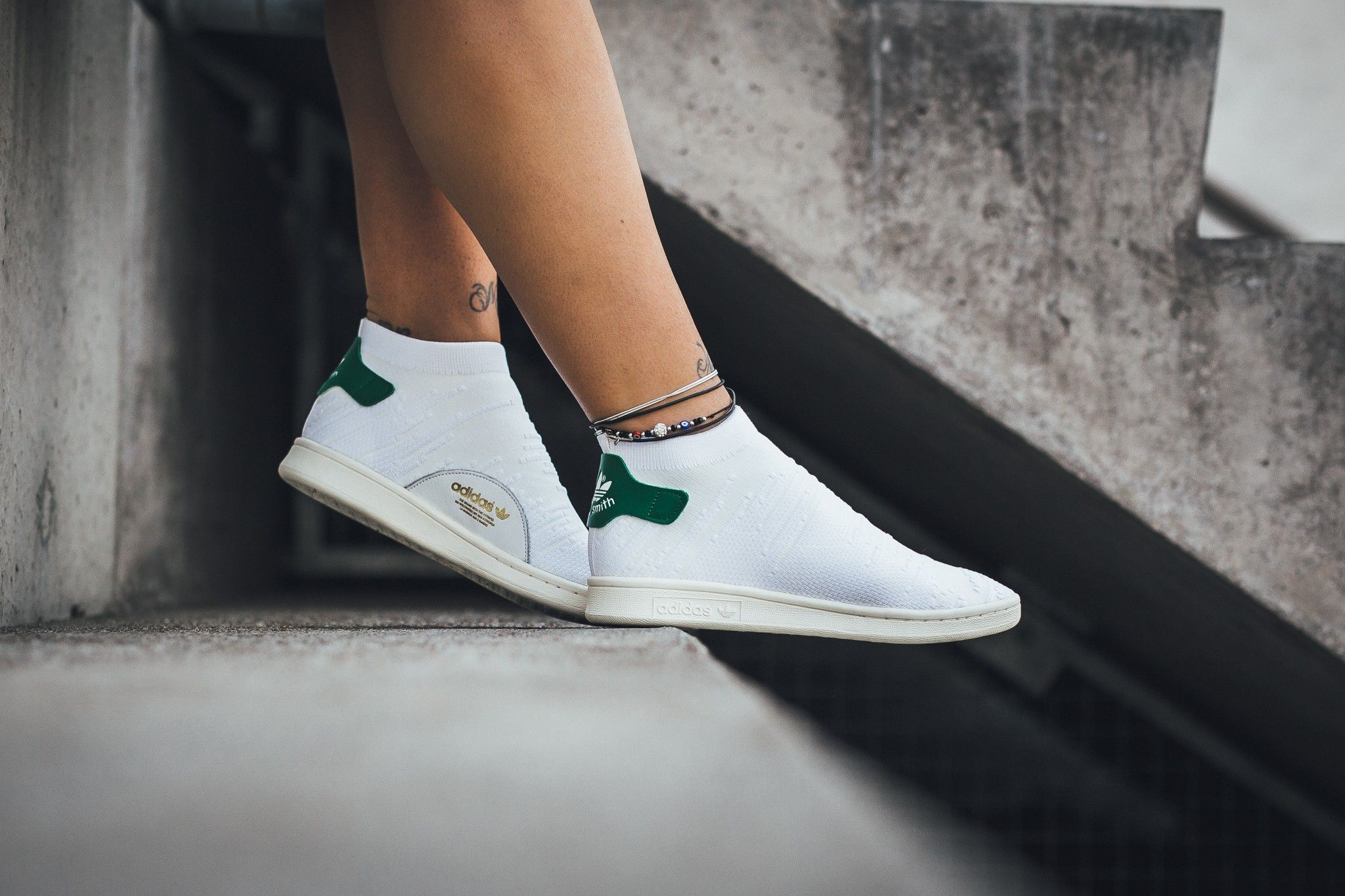bf83c981caa27 The adidas Stan Smith Sock Primeknit in footwear white green is featured in  another look