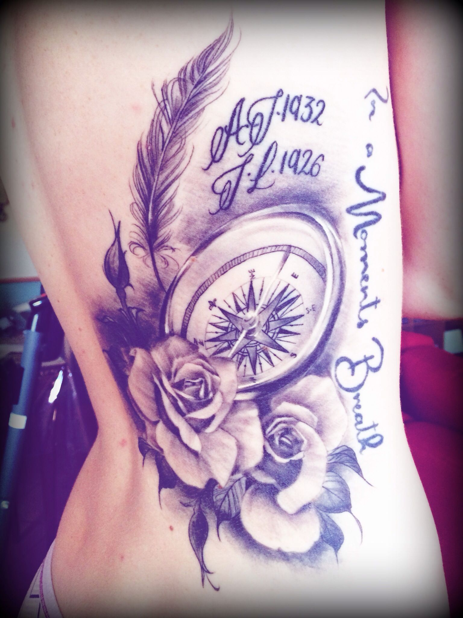 My tattoo for my grandparents compass, roses and feathers ...