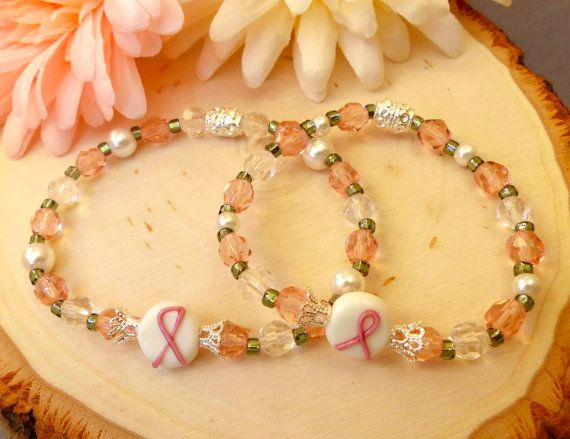 This is a beautiful handmade piece carefully crafted by Blossom with Hope. Designed with pink and crystal seed beads that are nicely accented with a pewter Hope awareness ribbon. This would make a special gift to a Mother and Daughter who have been affected by breast cancer. Product Details: Mother's Bracelets ~ Size 6 1/2 inches (16.5 cm), Daughter's Bracelet ~ Size 6 inches (15.2 cm), Style ~ Beaded & Stretch, Colors ~ Pink and crystal, Accents ~ Awareness glass bead, Silver tone accents