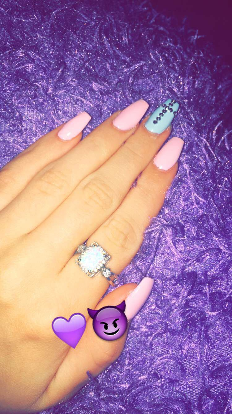 Pink and blue coven shaped nails with diamonds shaped as a cross ...