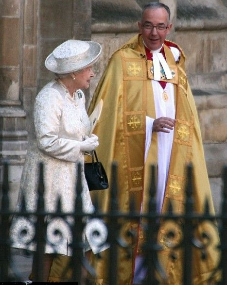 Queen Elizabeth talks to the Dean of Westminster as she leaves.